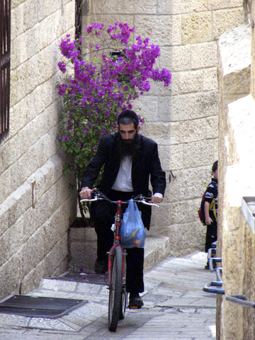Man on bicycle in Old City Alley
