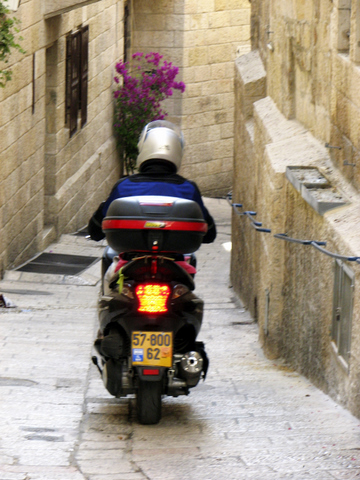 Man on motorcycle in the Old City Alley