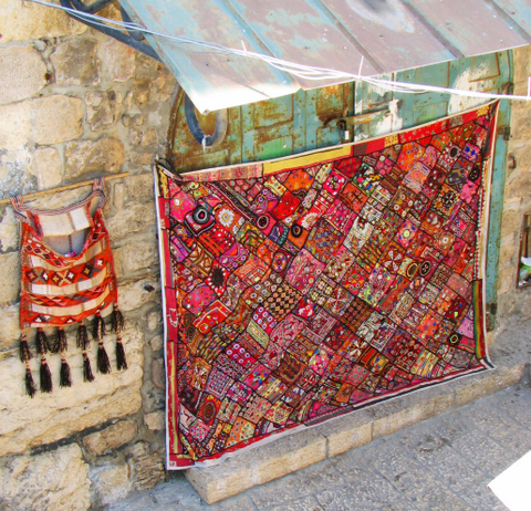 Bedouin quilt hung in the center of old city