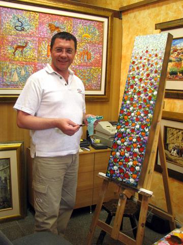 Artist (Victor Jerusalem) working in his gallery in Cardo