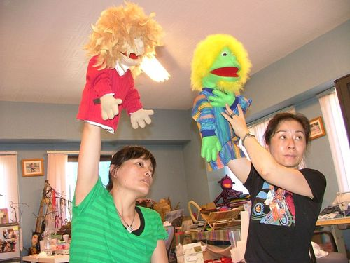 Linda helping Teresa with the puppet for mission trip